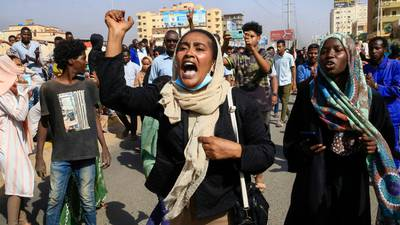 Photos: Sudanese protesters flood streets amid reports of possible military coup