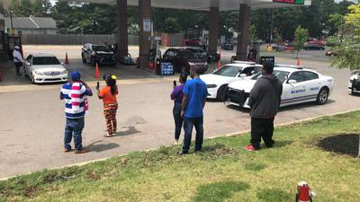 PHOTOS: Crowd continues to protest outside Kroger where man was shot and killed by security guard