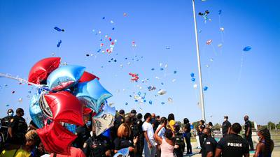 PHOTOS: Balloon release held for MPD officer killed by 18-wheeler